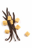 Vanilla beans and brown sugar. Well dried vanilla beans and brown sugar on a white background Royalty Free Stock Photo