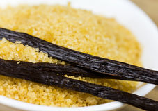 Vanilla beans and brown vanilla sugar, close up shot Stock Photography
