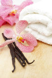 Vanilla beans, white towel and orchid flower Royalty Free Stock Photography