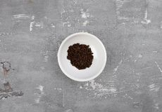 Vanilla in bowl on concrete Stock Photo