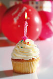 Vanilla buttercream cupcake with birthday candle Stock Photography