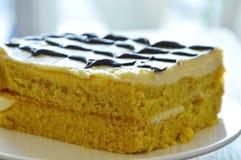 Vanilla cake decorate cream and chocolate on plate. Vanilla cake decorate cream and chocolate on white plate Stock Photo