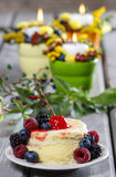Vanilla cake decorated with fresh fruits Royalty Free Stock Photos