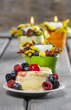 Vanilla cake decorated with fresh fruits Stock Images