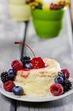 Vanilla cake decorated with fresh fruits Stock Image