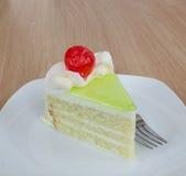 Vanilla cake slice and fresh cherry Stock Photos
