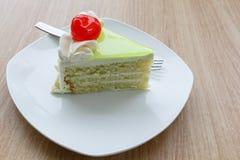 Vanilla cake slice and fresh cherry. Vanilla cake slice with fresh cherry Royalty Free Stock Image