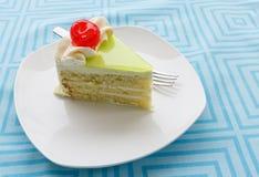 Vanilla cake slice and fresh cherry. Vanilla cake slice with fresh cherry Royalty Free Stock Photo