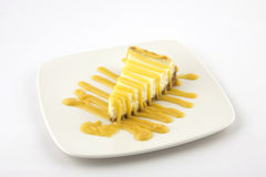Vanilla cheesecake on a white plate Stock Images