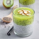 Vanilla chia pudding with kiwi, layered dessert, on concrete background, square format Stock Photos