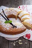 Vanilla, chocolate and almond cake on a stand Stock Images