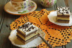Vanilla and chocolate cake. Delicious homemade vanilla and chocolate cake with a cream topping Stock Images