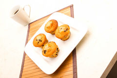 Vanilla with chocolate chips Muffins with a cup of coffee Stock Photo