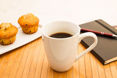 Vanilla with chocolate chips Muffins with a cup of coffee Royalty Free Stock Photo