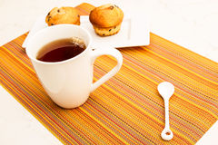 Vanilla with chocolate chips Muffins with a cup of tea Stock Images