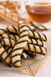 Vanilla and chocolate cookies and tea Royalty Free Stock Photography
