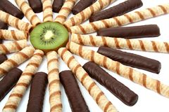 Vanilla chocolate sticks with a cream and sliced kiwi Stock Images