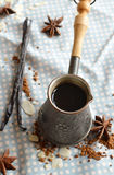 Vanilla coffee in the traditional cezve with a   vanilla pod. Royalty Free Stock Photo