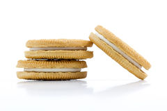 Vanilla cookies with cream filling on white background Stock Images