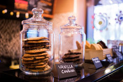 Vanilla cookies truffle with chocolate in glass jars on the shelves in the cafe Royalty Free Stock Images