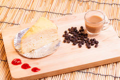 Vanilla crape cake and coffee on wood. Stock Photo
