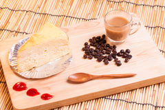 Vanilla crape cake and coffee on wood. Royalty Free Stock Photo