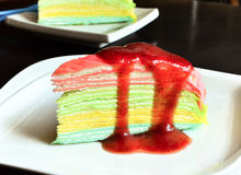 Vanilla crape cake on dish with strawberry jam Royalty Free Stock Image