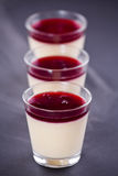Vanilla Cream With Cherry Topping Stock Photos