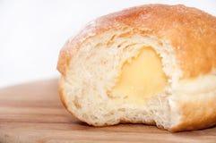 Vanilla cream in donut Stock Photography