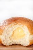 Vanilla cream in donut Stock Images