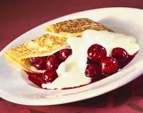 Vanilla crepe. With cherries and custard stock photography