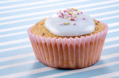 Vanilla cupcake with bright blue icing Royalty Free Stock Images
