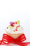 Vanilla cupcake with butter cream icing. And leaves on light background Royalty Free Stock Image
