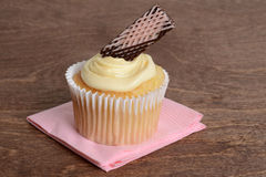 Vanilla cupcake with chocolate wafer Royalty Free Stock Images