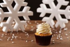 Vanilla cupcake on Christmas background Royalty Free Stock Images