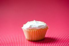 Vanilla cupcake with cream topping and crunchy cookies Stock Image