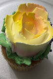 Vanilla cupcake decorated with floral design frosting Stock Photo