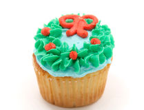 Vanilla cupcake with green blue and orange icing Royalty Free Stock Photo