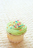 Vanilla cupcake with green lime icing Stock Image