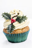 Vanilla cupcake with holly Royalty Free Stock Photography