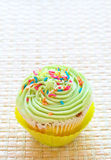 Vanilla cupcake with lime icing Royalty Free Stock Photos