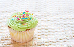 Vanilla cupcake with lime icing Stock Images