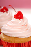 Vanilla cupcake with maraschino cherry Royalty Free Stock Images