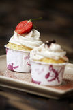 Vanilla cupcake and milk cream with strawberry Stock Photos