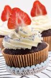 Vanilla cupcake with organic strawberry Royalty Free Stock Image