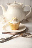 Vanilla cupcake ready to eat Stock Photography