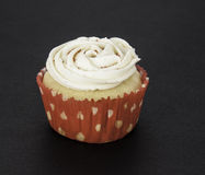 Vanilla Cupcake in Red and White Liner Royalty Free Stock Image