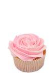 Vanilla cupcake with rose icing. Fresh vanilla cupcake with rose buttercream icing on white background Royalty Free Stock Photos