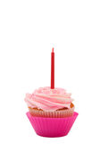 Vanilla cupcake with rose icing. Fresh vanilla cupcake with rose buttercream icing and birthday candle on white background Royalty Free Stock Photography