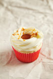 Vanilla cupcake with Salted caramel icing topping Stock Photo